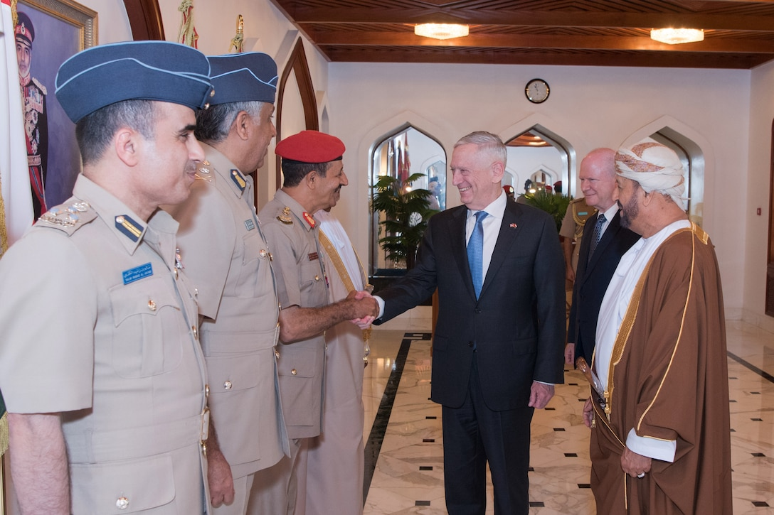 Defense Secretary James N. Mattis shakes hands with Omani service members.