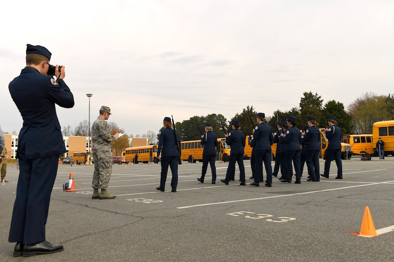 U.S Air Force Staff Sgt. Alexander Duncan, 145th Maintenance Squadron, grades Parkwood High School Air Force Junior Reserve Officers' Training Corps members on armed flight drill during the Patriot Classic Drill Competition held at Independence Hight School, Charlotte, N.C., March 10, 2018. Over 300 students from 14 high schools traveled from as far as 3 hours away to compete and were judged by volunteers from the North Carolina Air and Army National Guard.