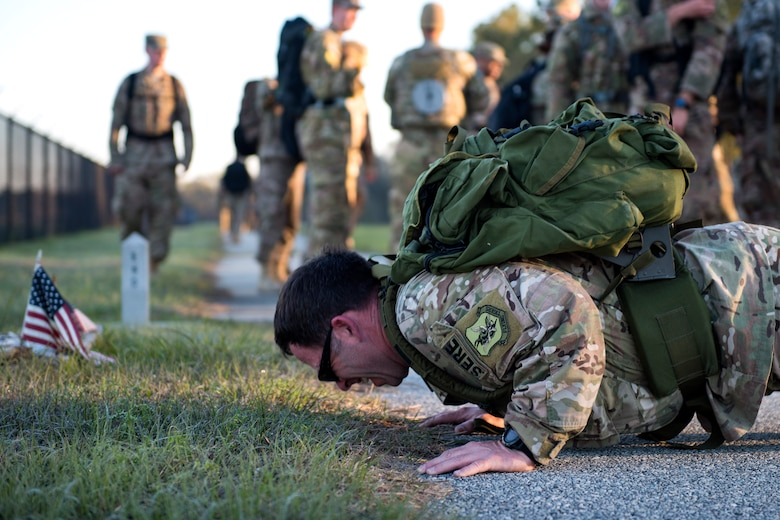 Tech. Sgt. Daniel Wiggins, 347th Operations Support Squadron (OSS) Survival, Evasion, Resistance, Escape specialist, performs pushups as part of a ruck march during a Comprehensive Airman Fitness (CAF) Day, March 9, 2018, at Moody Air Force Base, Ga. During CAF Day, the 347th OSS focused on the physical domain, bolstering resiliency through team building activities. (U.S. Air Force photo by Airman 1st Class Erick Requadt)