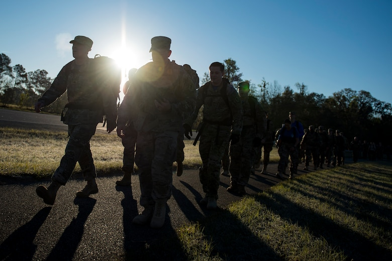 Airmen from the 347th Operations Support Squadron (OSS) participate in a ruck march during a Comprehensive Airman Fitness (CAF) Day, March 9, 2018, at Moody Air Force Base, Ga. During CAF Day, the 347th OSS focused on the physical domain, bolstering resiliency through team building activities. (U.S. Air Force photo by Airman 1st Class Erick Requadt)