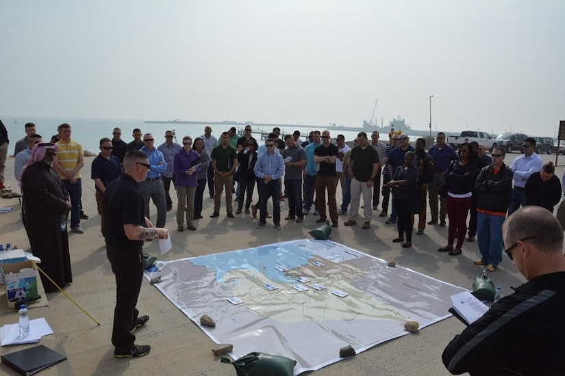 Captain Jeffery Johnson, Directorate of Public Works-South operations officer, leads a discussion at Kuwait Naval Base, Kuwait, March 1, 2018, on how the coalition developed their strategy to defeat the Iraqi military and overcame the hurdles of fighting in new terrain during Operation Desert Storm in 1991.