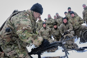 Soldiers give advice during multinational weapons training exercise