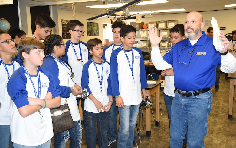 Martin Willis, a technology teacher at Jal Junior High, instructs his students at the Air Force Research Laboratory's La Luz Academy Robotic Challenge Expo March 9 at Kirtland. Willis brought 31 students to the event, that saw more than 100 students representing seven schools compete.