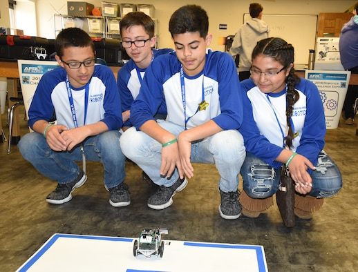 Brandon Truvino, Brandon Doss, Alex Carreon and Karen Sauceda test their robot programming on a simple maze at the Air Force Research Laboratory's La Luz Academy Robotic Challenge Expo March 9 at Kirtland. The seventh grade students are one of eight teams from Jal Junior High that competed at the annual event.