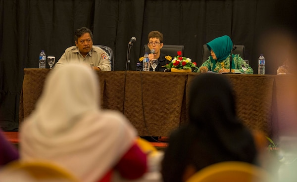 Dr. Pangarso Suryotomo (left), Kasubdit Peran Masyarakat National Disaster Management Authority, Royal New Zealand Navy Cmdr. Karen Ward, Pacific Partnership 2016 Women, Peace and Security lead, and Dr. Randa Mardanis (right), Women, Peace and Security seminar mediator, speak at a panel during the Pacific Partnership 2016 Women, Peace and Security seminar. The seminar gave Pacific Partnership personnel, local government and provincial officials an open forum to discuss the roles and requirements of women in disasters. This is the fifth time Pacific Partnership has visited Indonesia. Partner nations are working side-by-side with local organizations during disaster response training, civil engineering projects, Women, Peace, and Security seminars, medical subject matter expert exchanges and a live field training exercise aimed at improving the capacity of local government, civilian agencies and partner militaries to collectively respond in crisis.