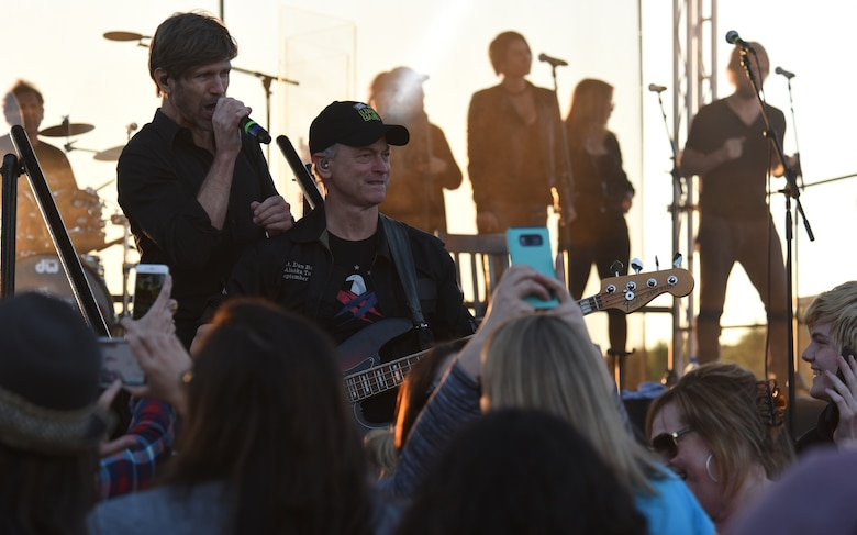 Jeff Vezain, Lt. Dan Band lead singer, sings a song while standing behind Gary Sinise, band founder, during a concert at Tyndall Air Force Base, Fla., March 4, 2018. (U.S. Air Force photo by Airman 1st Class Solomon Cook/Released)