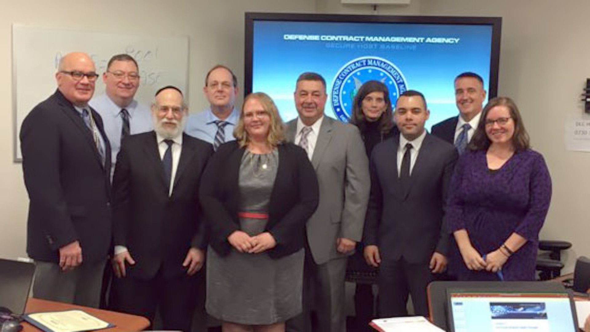 Michael Shields (center), executive director of Quality Assurance at the Defense Contract Management Agency, recently thanked the employees involved with the development of a new class, ENGR233, Technical Support to Indirect Costs. Employees (left to right): Christopher Brust; Anthony Labath; Stuart Harrow; Ken Pedeleose; Angelica Rogers; Shields; Julie Nesbit; José Ortiz; Kip Shepard; and Christina Payette. (DCMA photo by Harry Diaz Agosto)