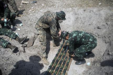 9th ESB EOD Marines work alongside Royal Thai service members to dispose of UXO