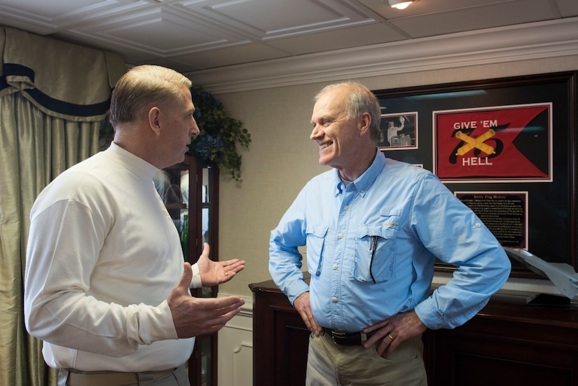 Navy Secretary Richard V. Spencer, right, speaks with Carrier Strike Group 8 Command Master Chief Petty Officer Michael Bates.