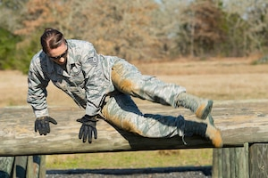 Air Force Tech. Sgt. Jennifer Brown, an education and training specialist with the Texas Air National Guard's 273rd Cyber Operations Squadron, jumps over an obstacle during the 2018 Best Warrior Competition near Bastrop, Texas, March 1, 2018. Texas Air National Guard photo by Staff Sgt. Agustin Salazar