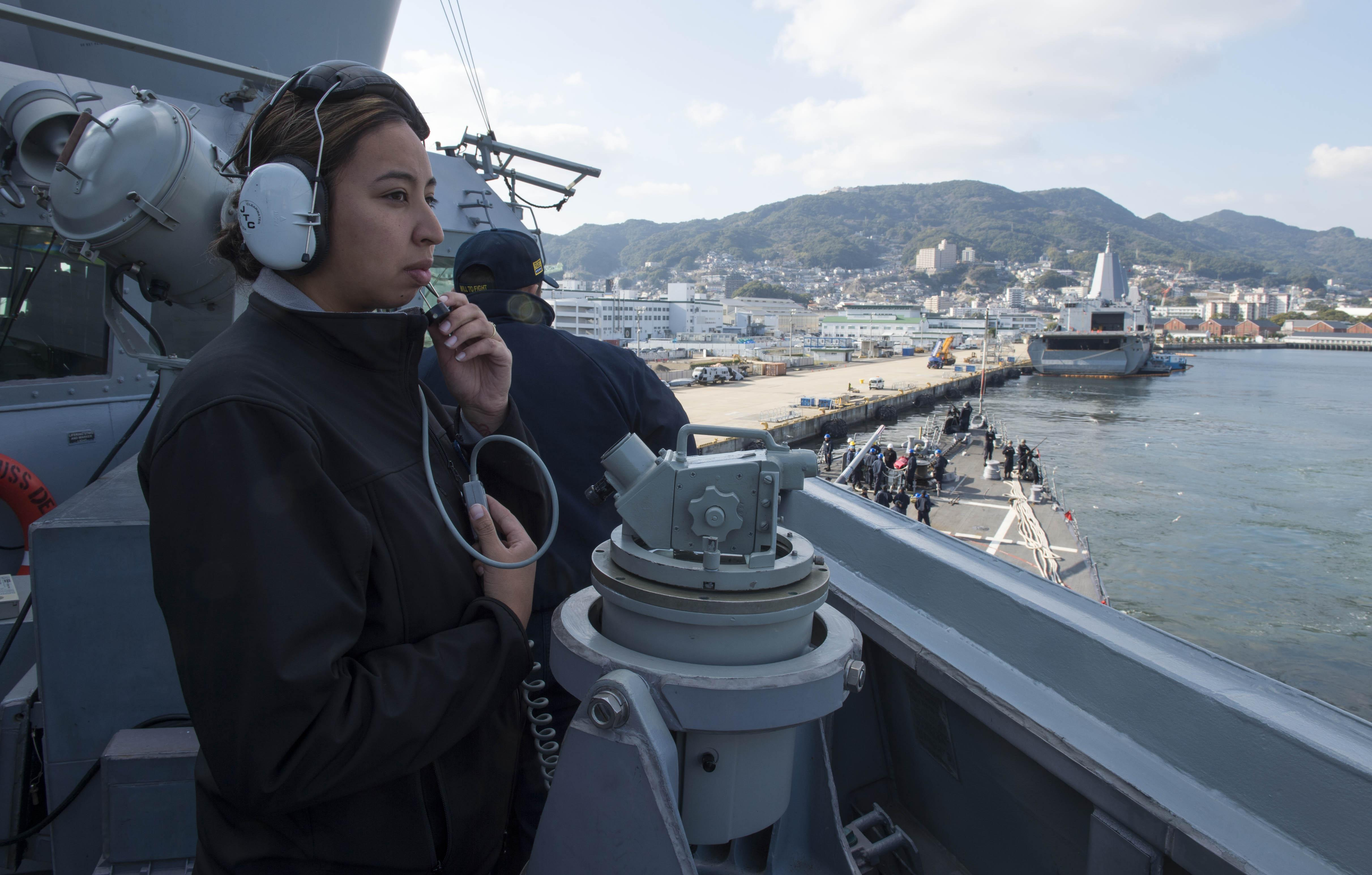 "The Arleigh Burke-class guided-missile destroyer USS Dewey (DDG 105), with embarked Helicopter Maritime Strike Squadron (HSM) 35 ""Magicians,"" joined up with the Wasp Expeditionary Strike Group March 12 following the ship's port visit in Sasebo."