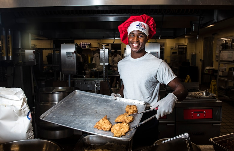 Airman 1st Class Tyrell Jackson presents his chicken parmesan batch during the Andersen Top Chef competition March 8, 2018, at Magellan Inn Dining Facility, Andersen Air Force Base, Guam. Jackson is a services apprentice and competed for the title of Top Chef of the Quarter by preparing a chicken parmesan dish. (U.S. Air Force photo by Staff Sgt. Alexander W. Riedel)