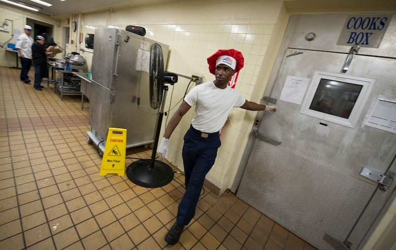 """Airman 1st Class Tyrell Jackson closes the door to the """"Cooks Box"""" freezer during a Top Chef competition March 8, 2018, at Magellan Inn Dining Facility, Andersen Air Force Base, Guam. Jackson is a services apprentice and competed for the title of Top Chef of the Quarter against fellow AIr Force and U.S. Army culinary specialists. (U.S. Air Force photo by Staff Sgt. Alexander W. Riedel)"""