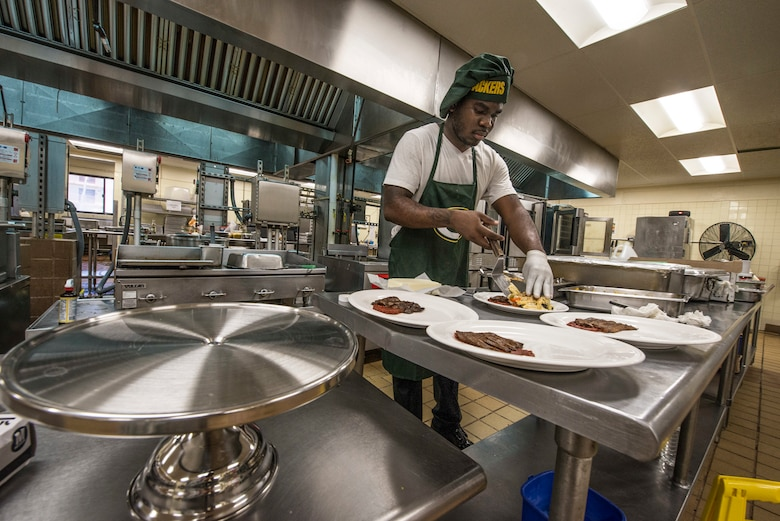 U.S. Army Specialist Kevron Usher, culinary specialist with Task Force Talon's  E Battery, 3rd Air Defense Artillery Regiment,  arranges ingredients of a meal during a Top Chef competition March 8, 2018, at Magellan Inn Dining Facility, Anderen Air Force Base, Guam. Usher prepared Italian steak with panini pasta and tomato sauce. Competitors' dishes were judged by a panel of Air Force, Army and civilian leaders in a variety of grading categories. (U.S. Air Force photo by Staff Sgt. Alexander W. Riedel)
