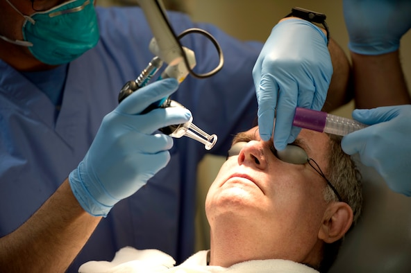 A dermatology patient, prepares to receive laser treatment on his nose at MacDill Air Force Base, Fla., March 9, 2018.