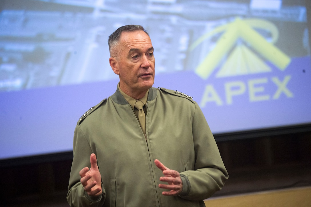 Marine Corps Gen. Joseph F. Dunford, Jr., chairman of the Joint Chiefs of Staff, speaks to new senior executives