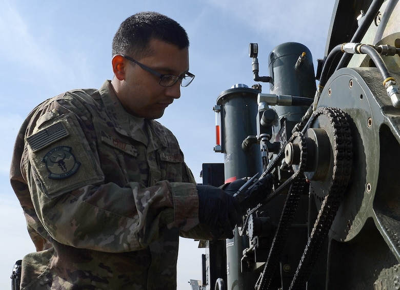 Airman Rene Cruz, 455th Expeditionary Civil Engineer Squadron power production engineer, inspects the chain on the Aircraft Arrest System Mar. 3, 2018 at Bagram Airfield, Afghanistan.
