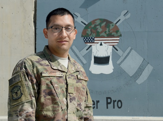 Airman Rene Cruz, 455th Expeditionary Civil Engineer Squadron power production engineer, poses for a photo Mar. 6, 2018 at Bagram Airfield, Afghanistan.