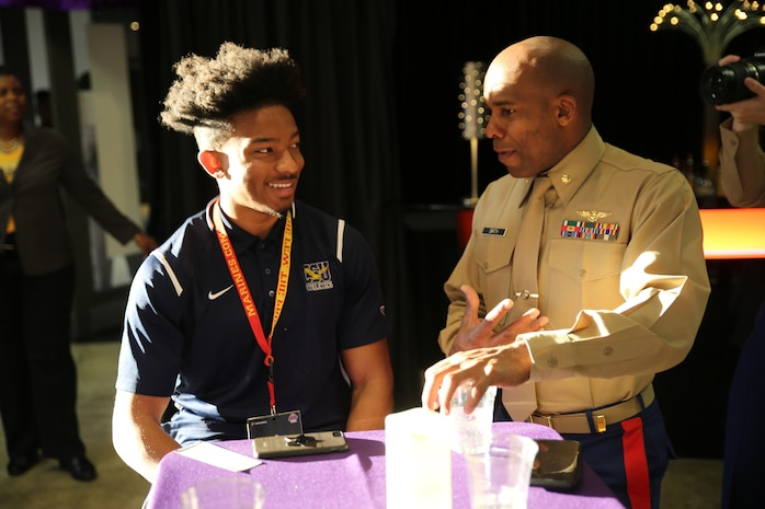 Maj. Paul Smith speaks to Devon Teagle about life goals and perseverance during at the 2018 Mid-Eastern Athletic Conference (MEAC) Marine Corps Battles Won Symposium Reception in Norfolk, Virginia, March 9. Teagle, a native of Abingdon, MD, and senior at Coppin State University is one of the 26 recipients of the U.S. Marines Leadership Awards recognized for his outstanding leadership in athletics, in the classroom and in his community. Smith is the strategic plans officer for 4th Marine Aircraft Wing, Marine Forces Reserve.