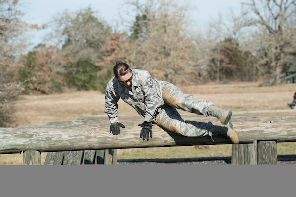 Tech. Sgt. Jennifer Brown, 273rd Cyber Operations Squadron education and training specialist, Texas Air National Guard, jumps over a obstacle course hurdle during the 2018 Best Warrior Competition March 1, 2018