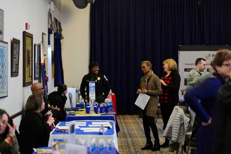 Team Dover spouses visit with various employers during the career information fair segment of the second annual Spouse Symposium March 7, 2018, at Dover Air Force Base, Del. Approximately 20 local employers attended the career information fair to explain employment opportunities to Team Dover spouses. (U.S. Air Force photo by Staff Sgt. Aaron J. Jenne)