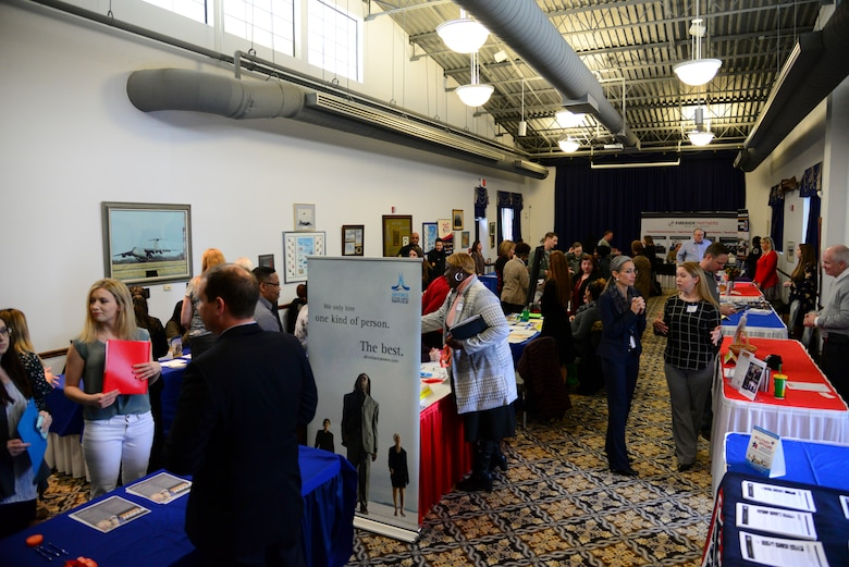 Team Dover Spouses interact with local employers during the career information fair segment of the second annual Spouse Symposium March 7, 2018, at Dover Air Force Base, Del. More than 40 spouses and 20 vendors attended the full-day event. (U.S. Air Force photo by Staff Sgt. Aaron J. Jenne)