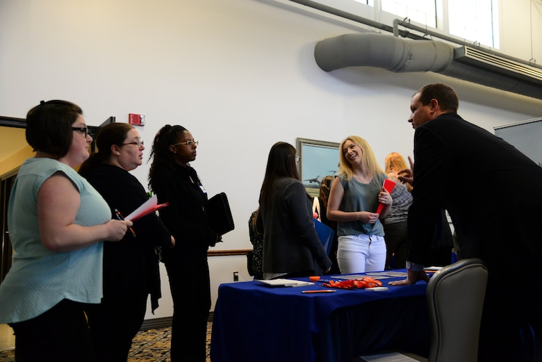 Spouses of Airmen assigned to Dover Air Force Base interact with local employers during the career information fair segment of the second annual Spouse Symposium March 7, 2018, at Dover AFB, Del. More than 40 spouses attended the full-day event to learn more about modern employment practices and to speak with local employers. (U.S. Air Force photo by Staff Sgt. Aaron J. Jenne)