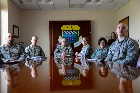 Representatives from Air Force Mortuary Affairs Operations and the 436th Medical Group join Air Force Surgeon General Lt. Gen. (Dr.) Mark Ediger (center) and Chief Master Sgt. George Cum (second from the left), Air Force Surgeon General medical enlisted force and enlisted corps chief, for a briefing about the AFMAO mission March 9, 2018, at Dover Air Force Base, Del. Ediger visited AFMAO, the Armed Forces Medical Examiner System, and held an all call for members of the 436th MDG during his visit. (U.S. Air Force photo by Staff Sgt. Aaron J. Jenne)