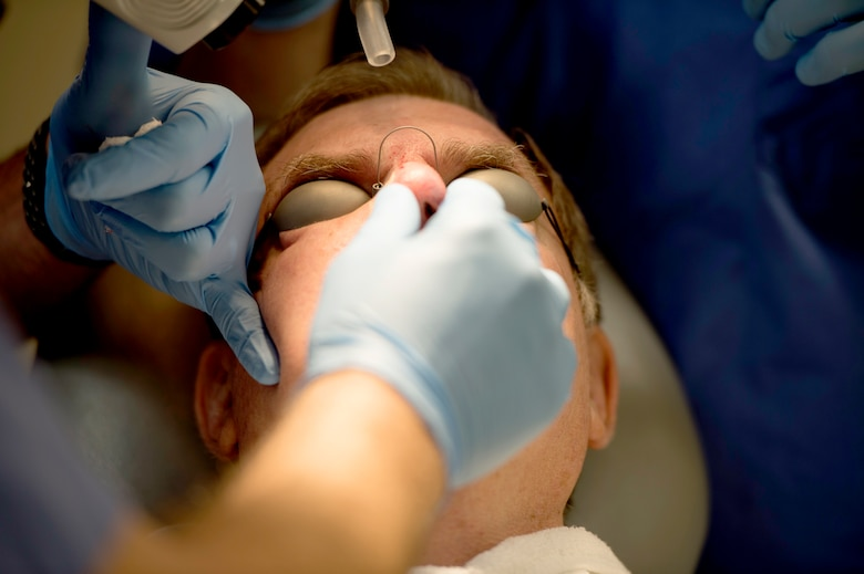 A dermatology patient, receives laser treatment on his nose at MacDill Air Force Base, Fla., March 9, 2018.