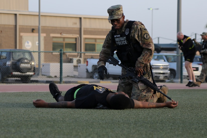 Specialist Jeremiah Matthews begins combat first aid on a simulated victim during a live-shooter and mass casualty exercise, March 7, 2018, Camp, Arifjan, Kuwait. The exercise was designed to test first responders and other emergency services that would be crucial during a real-world emergency.