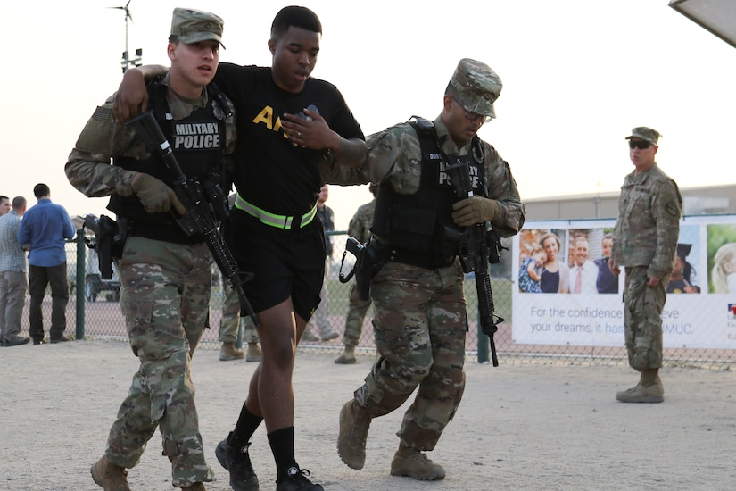 Private First Class Christian Ibarra, left, and Pfc. Matthew Dobson, both military police with the 202nd Military Police Company, escort a simulated victim of a mass shooting to a casualty collection point, Camp Arifjan, Kuwait, March 7, 2018. The exercise tested first responders and other emergency services that would be crucial during a real-world emergency.