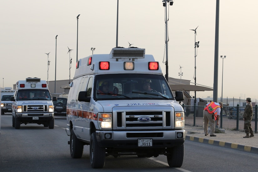 Camp Arifjan emergency medical workers move their ambulances to the casualty collection point during a simulated active shooter and mass casualty exercise, Camp Arifjan, Kuwait, March 8, 2018. The exercise tested first responders and other emergency services that would be crucial during a real-world emergency.