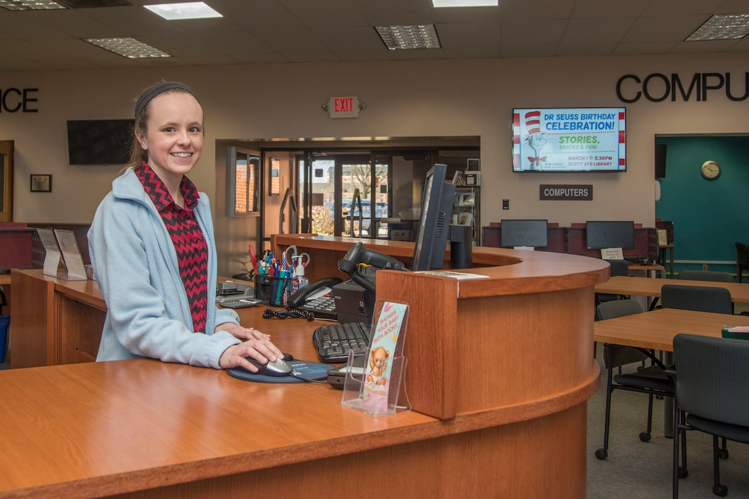 Stephanie Graves, 375th Force Support Squadron library aid, checks for a book's availability Feb. 26, 2018, at Scott Air Force Base, Ill. The Scott Air Force Base Library has been recently remodeled with all new furniture and shelving giving the library a more modern look. (U.S. Air Force photo by Senior Airman Melissa Estevez)