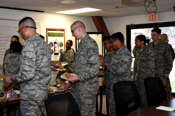 Goodfellow Air Force Base service members have lunch before participating in a speed mentoring program hosted by the 17th Force Support Squadron at the Airman and Family Readiness Center at Goodfellow Air Force Base, Texas, March 12, 2018. The event served as a kickoff for other events scheduled throughout the month for Women's History Month. (U.S. Air Force photo by Airman 1st Class Seraiah Hines/Released)