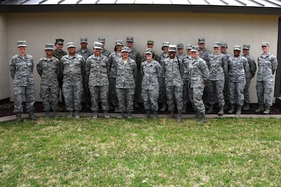 Mentors and mentees take a moment for a picture before heading back to work after the speed mentoring event hosted by the 17th Force Support Squadron at the Airman Family Readiness Center on Goodfellow Air Force Base, Texas, March 12, 2018. In recognition of Women's History Month, service members were invited to attend a mentoring session with various military members stationed at Goodfellow. (U.S. Air Force photo by Airman 1st Class Seraiah Hines/Released)