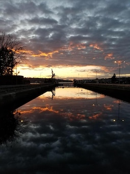 The sun rises as seen from the Hiram M. Chittenden Locks (Ballard Locks) March 11, 2018.