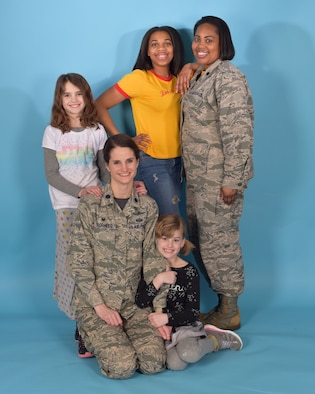 Lt. Col. Stacie Voorhees, left, 100th Communications Squadron commander, and Lt. Col. Carina Harrison, 100th Force Support Squadron commander, pose with their daughters at RAF Mildenhall, England, Feb. 23, 2018. These leaders tell their story on how they surpass the sometimes colliding responsibilities of family and duty. (U.S. Air Force photo by Airman 1st Class Alexandria Lee)