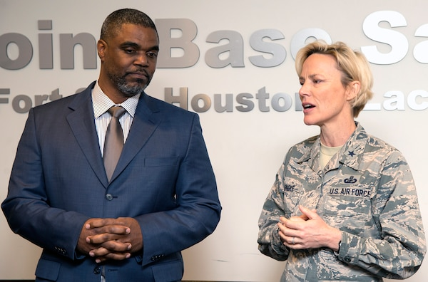 Brig. Gen. Heather Pringle (right), 502nd Air Base Wing and Joint Base San Antonio commander, thanks Garrick Williams (left), JBSA Energy Solutions director with CPS Energy, at the 502nd ABW headquarters at JBSA-Fort Sam Houston March 13, after he presented JBSA with a rebate check for $62,763.04.