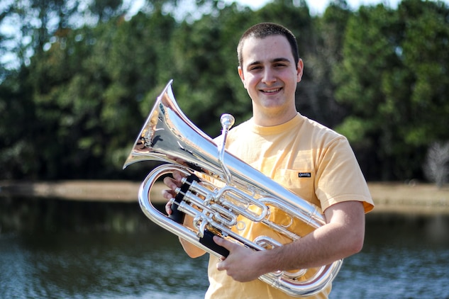 David Alan Beresoff Jr. shows off the euphonium, which is the instrument he will play as a musician in the Marine Corps, February 16, 2018.  His Marine Corps recruiters from Recruiting Substation Wilmington, North Carolina, are mentally and physically preparing him and other applicants for the challenges of Marine Corps Recruit Training. He practices playing the euphonium 3 hours every day to prepare himself for the Marine Corps Band.  (U.S. Marine Corps Photo by Sgt Antonio J. Rubio/Released)