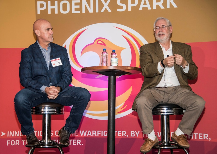 Peter Newell, BMNT managing partner, left, and Steve Blank, Stanford University adjunct professor of managment science and engineering, speak at the Spark Innovation Summit at March 6, 2018, at Travis Air Force Base, Calif. The Phoenix Spark program is a grassroots innovation program whose mission is to bring tomorrow's tools to the warfighter today. Phoenix Spark forms collaborative parnterships between the military's operational experts and the top problem solvers in the industry, academia and government agencies. (U.S. Air Force photo by Staff Sgt. Nicole Leidholm)