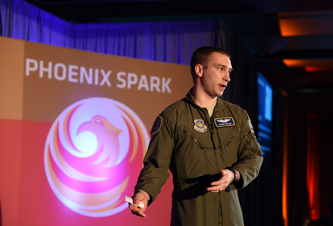 Capt. Jason Taylor, deputy chief of future concepts and transformations at Air Mobility Command headquarters, briefs summit attendees on AFWERX implementation March 6, 2018. Taylor joined speakers from AFWERX, Travis Air Force Base, California and Silicon Valley in addressing the summit. (U.S. Air Force photo by Airman 1st Class Christian Conrad)