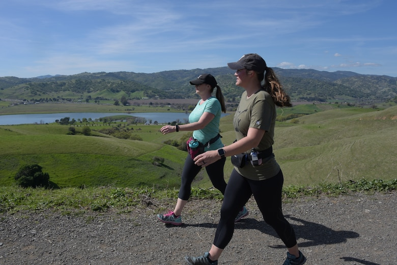 Senior Master Sgt. Jenny Hendry (Left), 60th Aeromedical Squadron, hikes up a hill at Pena Adobe Regional Park in Vacaville, Calif., with her cousin, Tech. Sgt. Nikki Webb, 60th Air Mobility Wing March 11, 2018. Hendry joined Webb on a 10-mile hike as she prepares for the Bataan Memorial Death March on March 25. (U.S. Air Force photo/Tech. Sgt. James Hodgman)