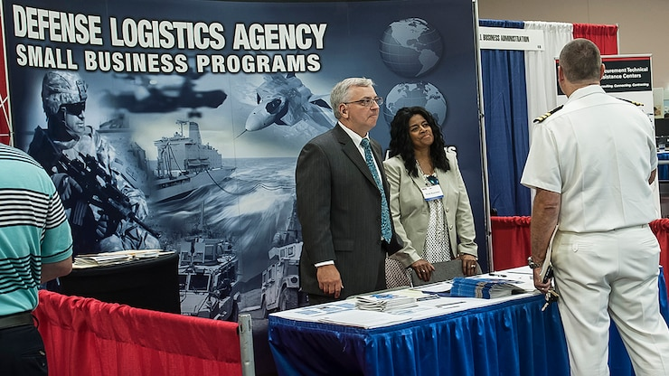Two DLA representatives talk about DLA at a DLA Small Business booth