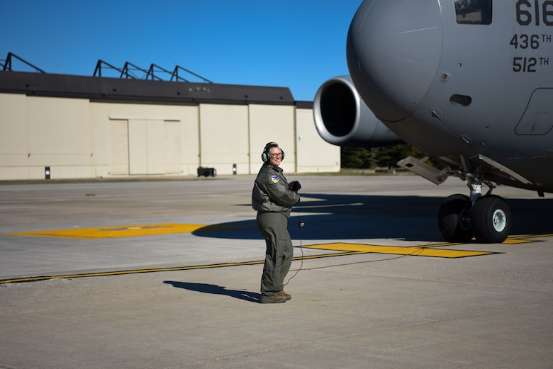 Senior Master Sgt. Lori Tascione, 3rd Airlift Squadron superintendent, scans for engine start March 5, 2018, at Dover Air Force Base, Del. Tascione joined an all-female crew to fly the final flight of her career. (U.S. Air Force Photo by Airman 1st Class Zoe M. Wockenfuss)