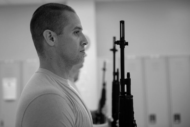 Tech. Sgt. Dallas Ayers, 823d Base Defense Squadron assistant flight chief, presents arms using his rifle, March 2, 2018, at Moody Air Force Base, Ga. Ayers is preparing to make the transition from protecting lives in combat to honoring the Air Force. He was recently selected for the U.S. Air Force Honor Guard and will begin his honor guard technical school April 16. (U.S. Air Force photo by Airman 1st Class Erick Requadt)