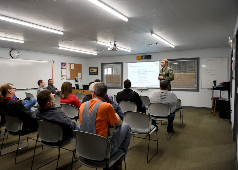 U.S. Air Force Capt Jason Heffner, a flight safety officer assigned to the 97th Air Mobility Wing, gives a safety briefing to civilian pilots and pilots in training, March 10, 2018, at Altus Air Force Base, Okla.