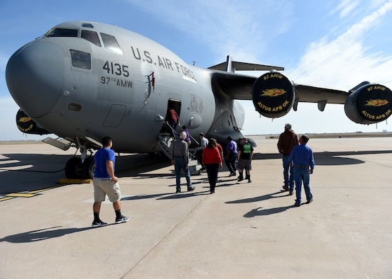 Civilian and training pilots tour a static display of a C-17 Globemaster III, March 10, 2018, at Altus Air Force Base, Okla.