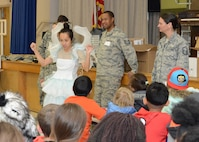 The Oral Hygiene Fairy, played by Capt. Josephine Nguyen, 412th Aerospace Medicine Squadron general dentist, gives dental tips to students at Branch Elementary March 1. Members of the 412th Medical Group dropped by the school as part of their recognition of National Children's Dental Health Month. (U.S. Air Force photo by Kenji Thuloweit)