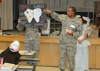 Tech. Sgt. Robert Penn, 412th Aerospace Medicine Squadron, discusses bad and good oral hygiene habits in front of Branch Elementary first graders March 1. Members of the 412th Medical Group dropped by the school as part of their recognition of National Children's Dental Health Month. (U.S. Air Force photo by Kenji Thuloweit)