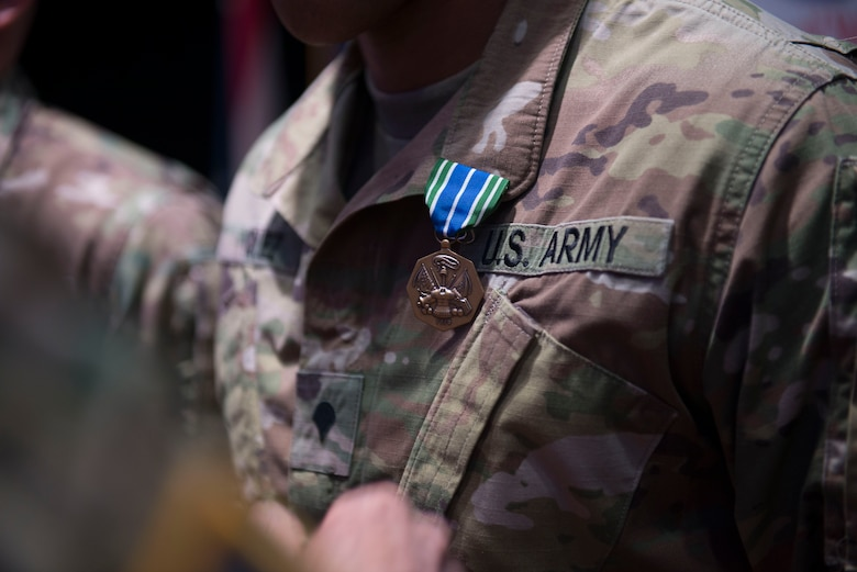 A U.S. Army Soldier wears an Army achievement medal in Wylie Theater at Joint Base Langley-Eustis, Virginia, March 1, 2018. The award ceremony concluded the week-long 597th Trans. Bde. Rapid Support Challenge. (U.S. Air Force photo by Monica Roybal)